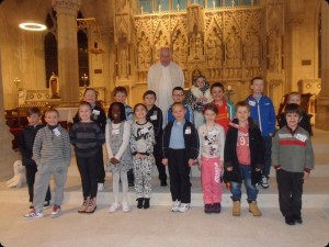 2nd class pupils pictured with Fr. Richie after celebrating the sacrament of reconciliation